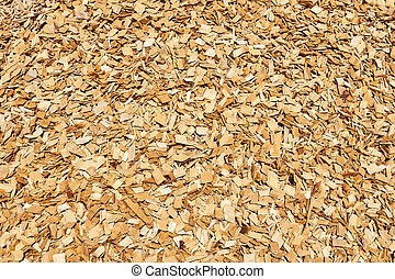 background - pile of wood woodchips, woodworking waste