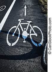shadow bicycle wheel on the road