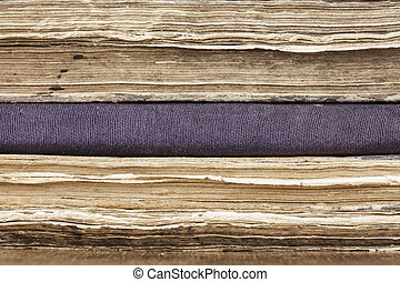 Background stack of old books closeup