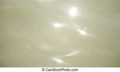 Reflections of sunlight on seawater - Background stars....
