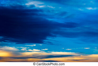 Background texture of dramatic sunset sky with clouds after thunderstorm