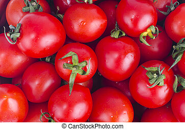 Background, texture, pattern of fresh red tomatoes