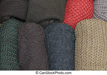 top view of open drawer with wool sweaters