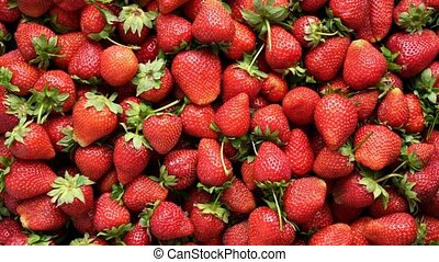 Background top view of strawberries rotating - Background...