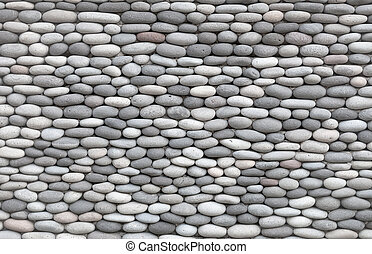 Background - wall decorated with smooth stones - Background...