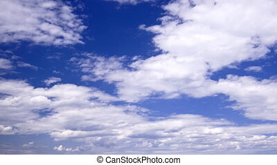 Background: White clouds form on a pretty blue sky.
