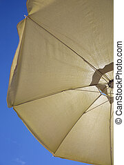yellow sun umbrella - background with a big yellow sun ...