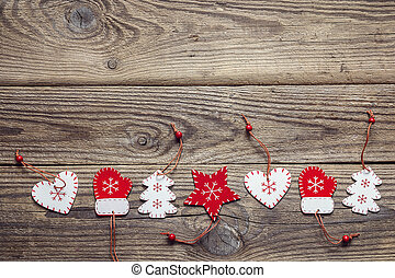 Background with a border of Christmas decorations on an old wooden table. Space for text.