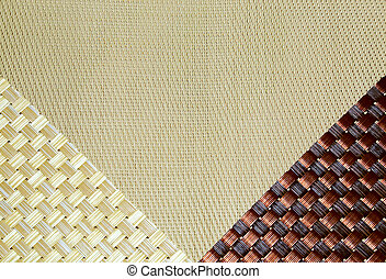 Background with a texture and with a diagonal weave, a kitchen napkin beige and brown in the form of contrasting triangles.