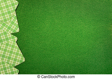 Background with cards on green felt casino table