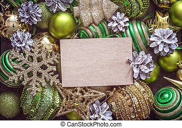 Background with Christmas decorations and blank paper card.