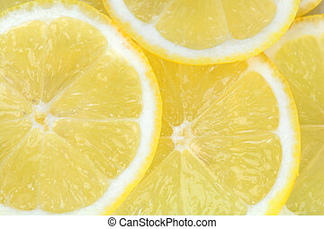 Background with citrus fruit of lemon slices