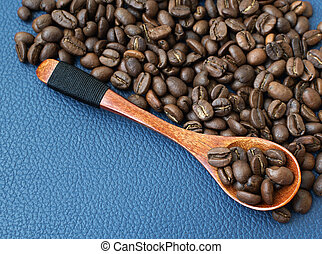background with coffee beans and wooden spoon