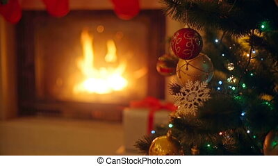 Background with colorful baubles on Christmas tree next to...