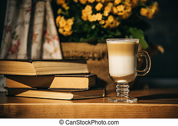 Background with cup of coffee , flowers and book