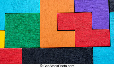 Background with different colorful shapes wooden blocks. Puzzle, mind game and toy