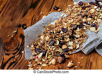 Background with dry muesli on old wooden desk