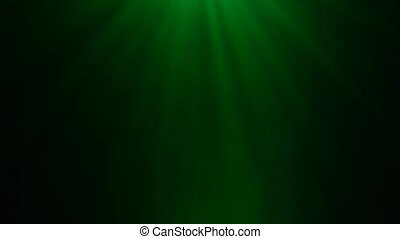 Background with green bright rays from the light