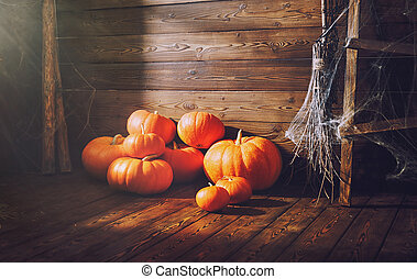 Background with Halloween. pumpkins on wooden background