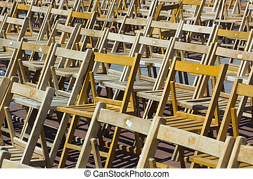 background with many wooden chairs lined