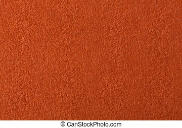 Background with orange felt texture for your unique project.