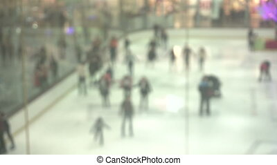 background with People skate on the ice at the mall