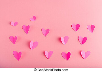background with pink hearts made of paper