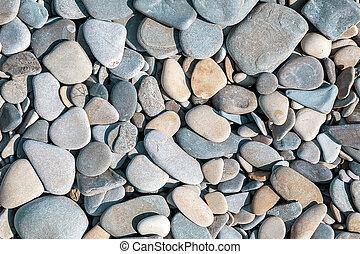 Background with round peeble stones close up