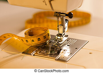 Background with sewing tools meter and machine