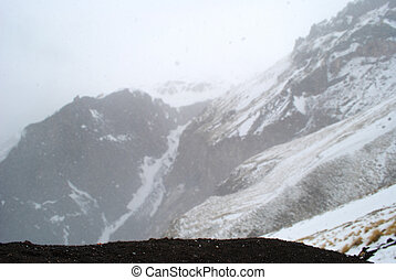 Background with snowy mountains in Caucasus