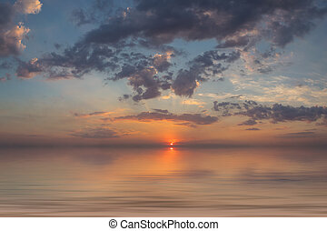 Background with sunset above sea