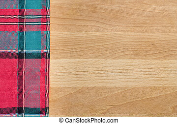 Background with tablecloth over wooden cutting board