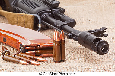 AK47 - background with the cartridges and the AK47