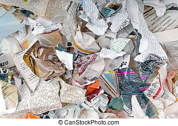 background with variety of different torn newspapers and magazines