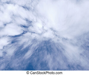 Background with white beautiful windy clouds on the blue sky