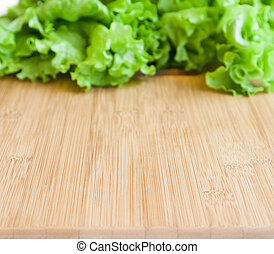 background with wooden board and leaf lettuce