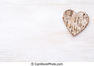 Background with wooden hearts, place for text.