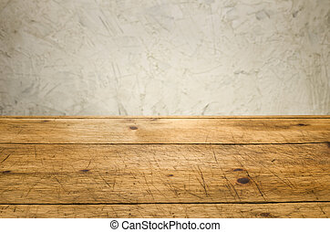 Background with wooden table and a rustic wall