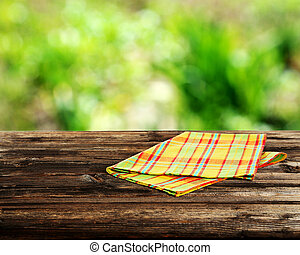 Background with wooden table with napkin