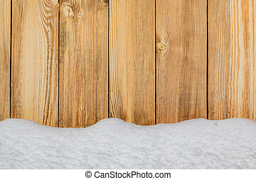 Background. Wooden boards are in the snowdrift.