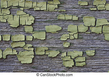 Background Wooden surface with cracked green paint