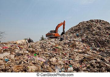 backhoe, décharge ordures