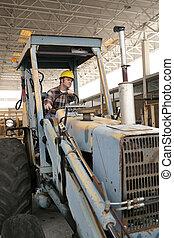 backhoe, de arbeider van de bouw