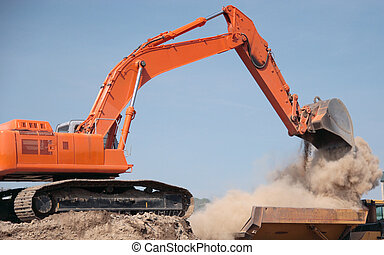 Backhoe Scooping Dirt - Large Construction equipment,...