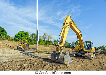 Backhow and Bulldozer - Machinery Clearing a Building Site
