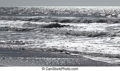 Backlight sea - Waves on the sea or ocean from a backlight...