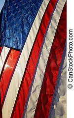 Backlighted American flag on front porch.