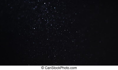 backlit background of real dust glittering