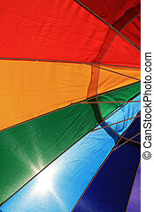 backlit beach umbrella - part of a colorful beach umbrella...