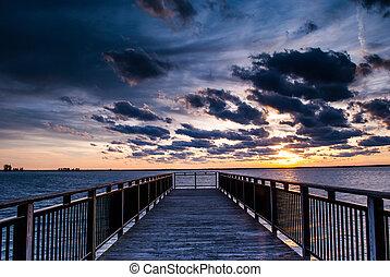 Backlit buffalo pier at sunset